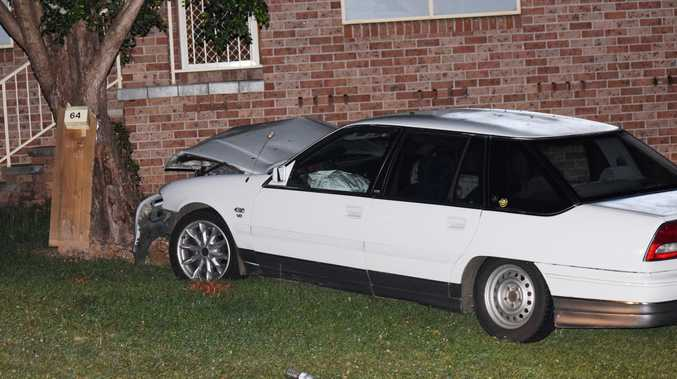 A car crashed through the front yard of a Coffs Harbour home on Friday night with the alleged driver failing a roadside breath test.