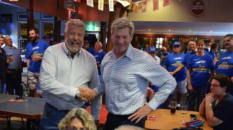 Retiring member Ian Rickuss congratulates Jim McDonald on his victory at Porter's Plainland Hotel.  PHOTO: Francis Witsenhuysen.