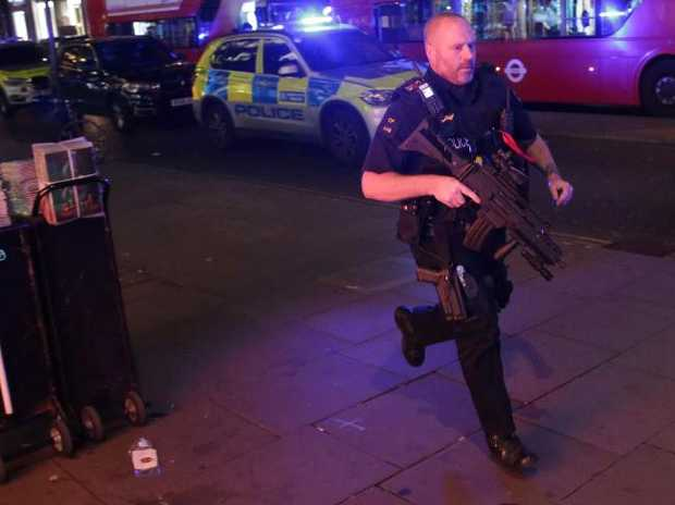 An armed policeman runs down Oxford Street in central London as police responded to an incident. Picture:  AFP