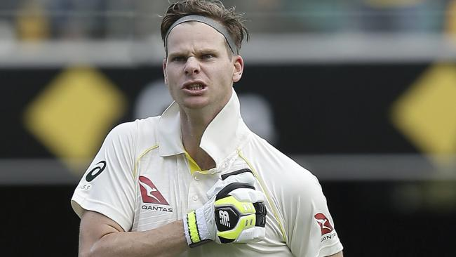 Steve Smith pounds his chest, urging his teammates to follow his lead after notching his 21st century.