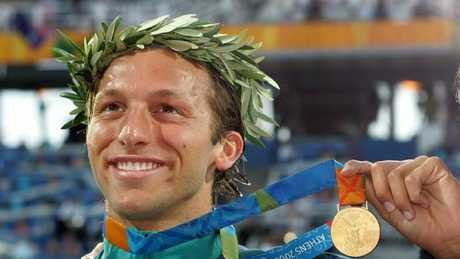 Ian Thorpe with one of his gold medals from the 2004 Olympic Games.