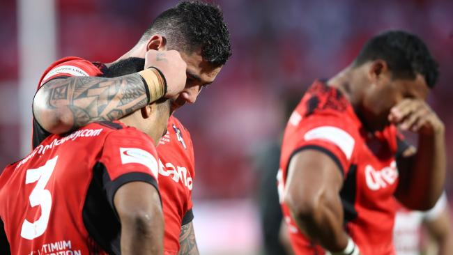 Michael Jennings and Andrew Fifita console each other following Tonga's dramatic loss to England.