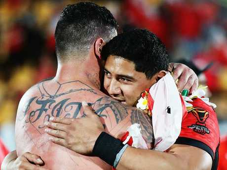 Tonga stars Andrew Fifita and Jason Taumalolo embrace after their loss to England.