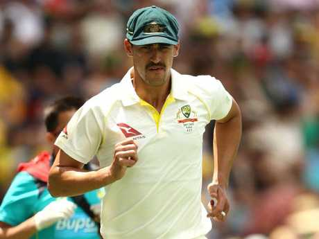 Mitchell Starc runs off a leg injury on the boundary.
