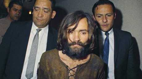 Charles Manson is escorted to his 1969 arraignment on conspiracy-murder charges in connection with the Sharon Tate murder case. Picture: AP