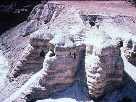 The caves at Qumran where the Dead Sea Scrolls were discovered. The graveyard of an ancient settlement has been excavated nearby.