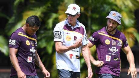 Anthony Milford, Wayne Bennett and Ben Hunt chat during a Broncos training session earlier this year.