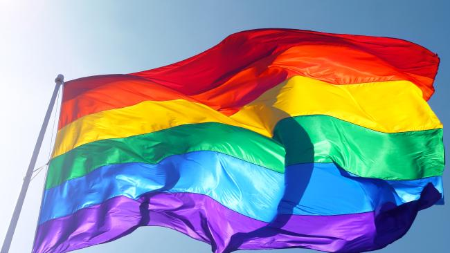 Ashfield resident Daniel Comensoli was told to take down his rainbow flag from outside his unit.