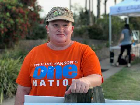 DAY IN THE SUN: One Nation volunteer Tracey Borodin at the St Augustine's College polling booth in the electorate of Jordan.
