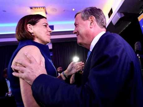 Queensland Opposition Leader Tim Nicholls hugs Deputy opposition leader Deb Frecklington (left) after speaking at the LNP Election function during the night of the 2017 Queensland Election, in Brisbane, Saturday, November 25, 2017. Nicholls joined LNP supporters to watch the election results.