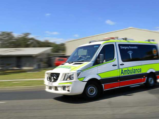 Queensland Ambulance Service Paramedics on the way to the scene of a battery explosion.