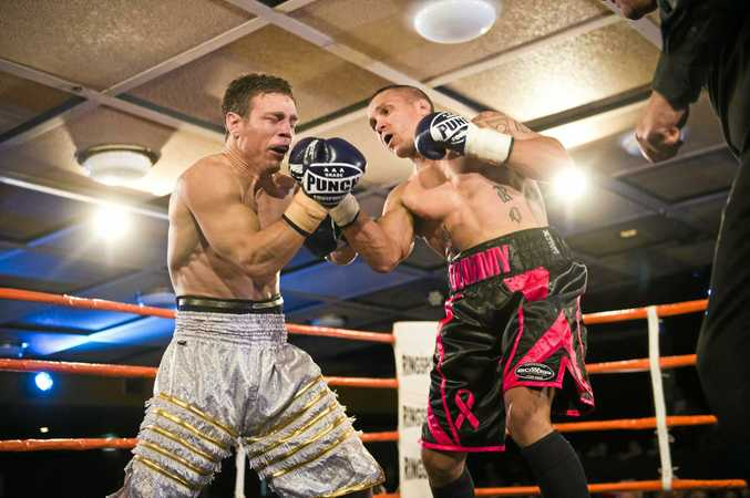 FIGHT NIGHT: Michael Katsidis (left) and Robert Toomey trade blows during their Super8 quarter final. Katsidis went on to win the fight.