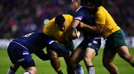 Taniela Tupou charges into the Scottish defence.