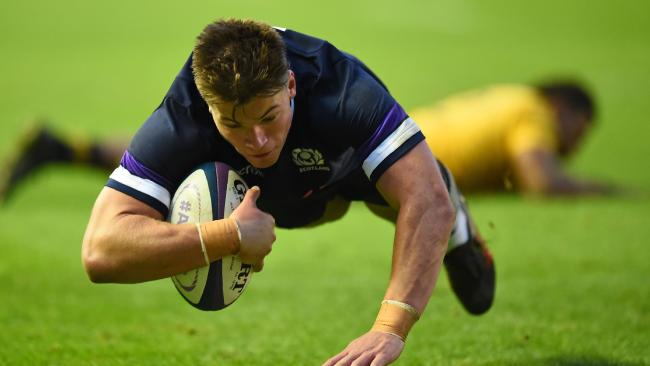 Scotland centre Huw Jones leaves the Wallabies defence in his wake.
