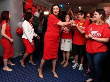 Queensland Premier Annastacia Palaszczuk is greeted by supporters as she arrives to an election night function at the Oxley Golf Club in Brisbane. Picture: Dan Peled/AAP