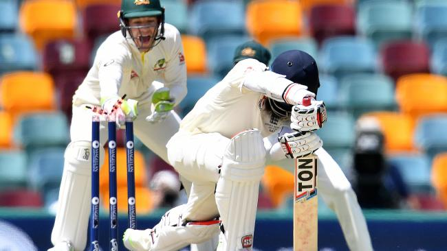 Tim Paine removes the bails to dismiss Moeen Ali on Sunday.