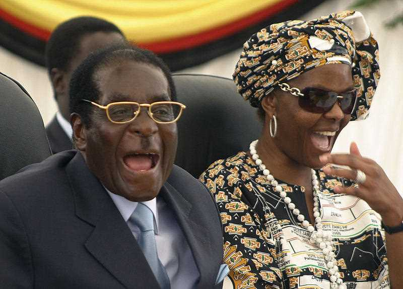 Former Zimbabwean President Robert Mugabe (R) and his wife First Lady Grace.