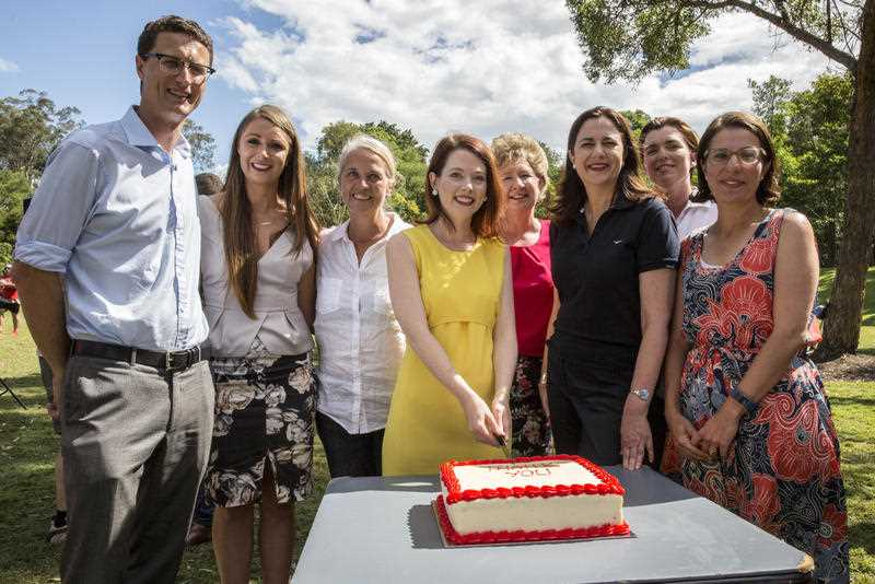 Queensland Premier Annastacia Palaszczuk cuts a cake with winning Labor candidates at a barbecue at Rocks Riverside Park, Seventeen Mile Rocks the day after the 2017 Queensland election, Brisbane, Qld, Sunday 26, 2017.