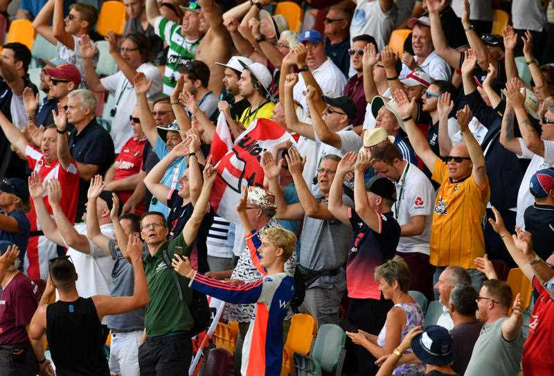 Members of the Barmy Army are seen cheering on Day 4 of the First Ashes Test match between Australia and England at the Gabba in Brisbane, Sunday, November 26, 2017.
