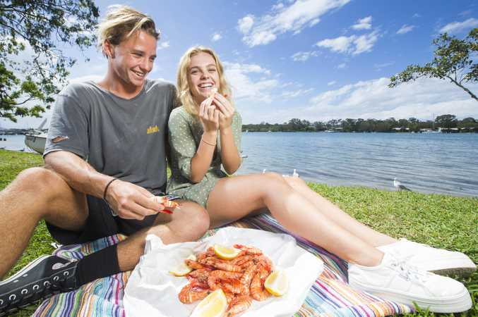 Oliver Reeves 18 and Molly Bagnara 18 enjoy some Mooloolaba caught Prawns by the Noosa River for lunch.