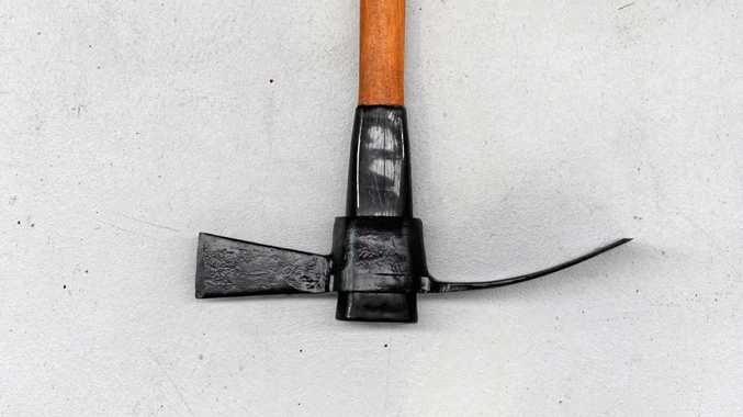 FRIGHTENING: A mother chased her daughter with a mattock.
