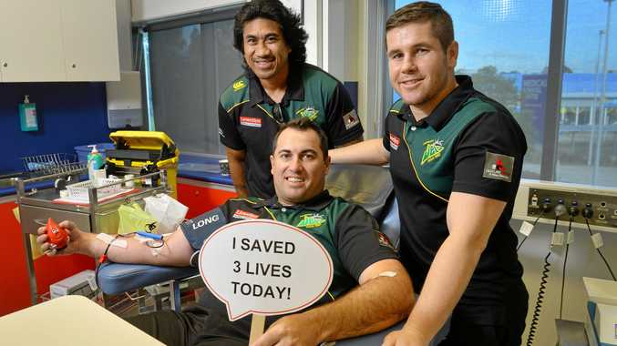 Ipswich Jets CEO Jason Cubit and players David Fa'alogo and Dane Phillips are donating blood at the Ipswich blood donor centre.