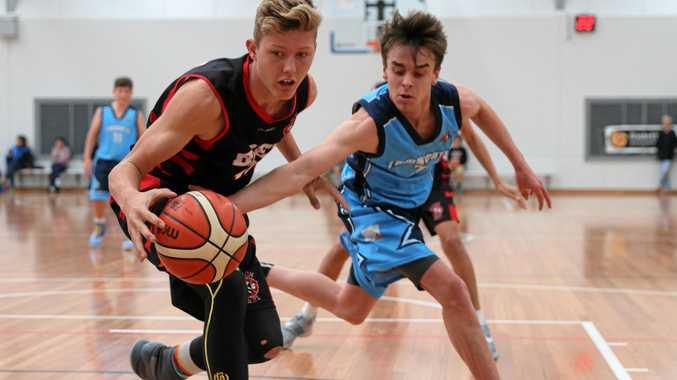 BASKETBALL: Byron Bay basketballer Harry Blair at left.