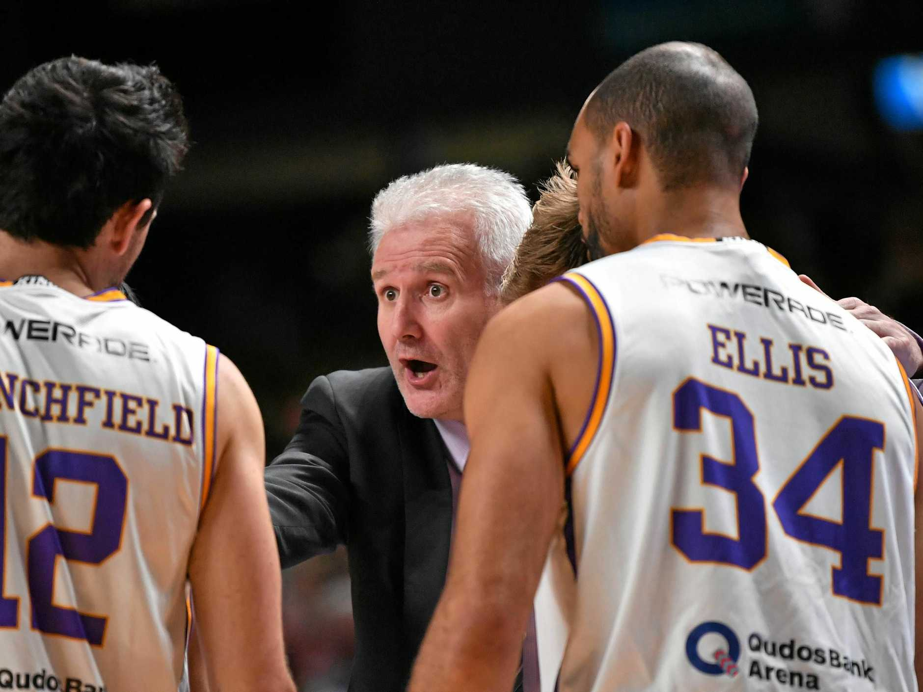 Sydney Kings head coach Andrew Gaze talks to his players.
