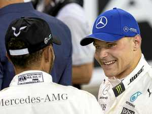 Bottas holds nerve to end season on high