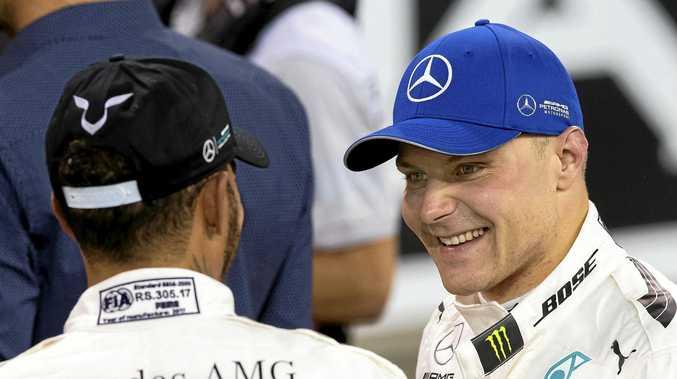 Finnish driver Valtteri Bottas (right) of Mercedes talks with his teammate Lewis Hamilton.