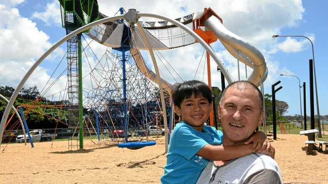 ADVENTURE AWAITS: Liam Pavicic (left) with his dad John outside the Pialba Adventure Playground. Liam is excited to try out the slides and the climbing net at the new park when it opens.