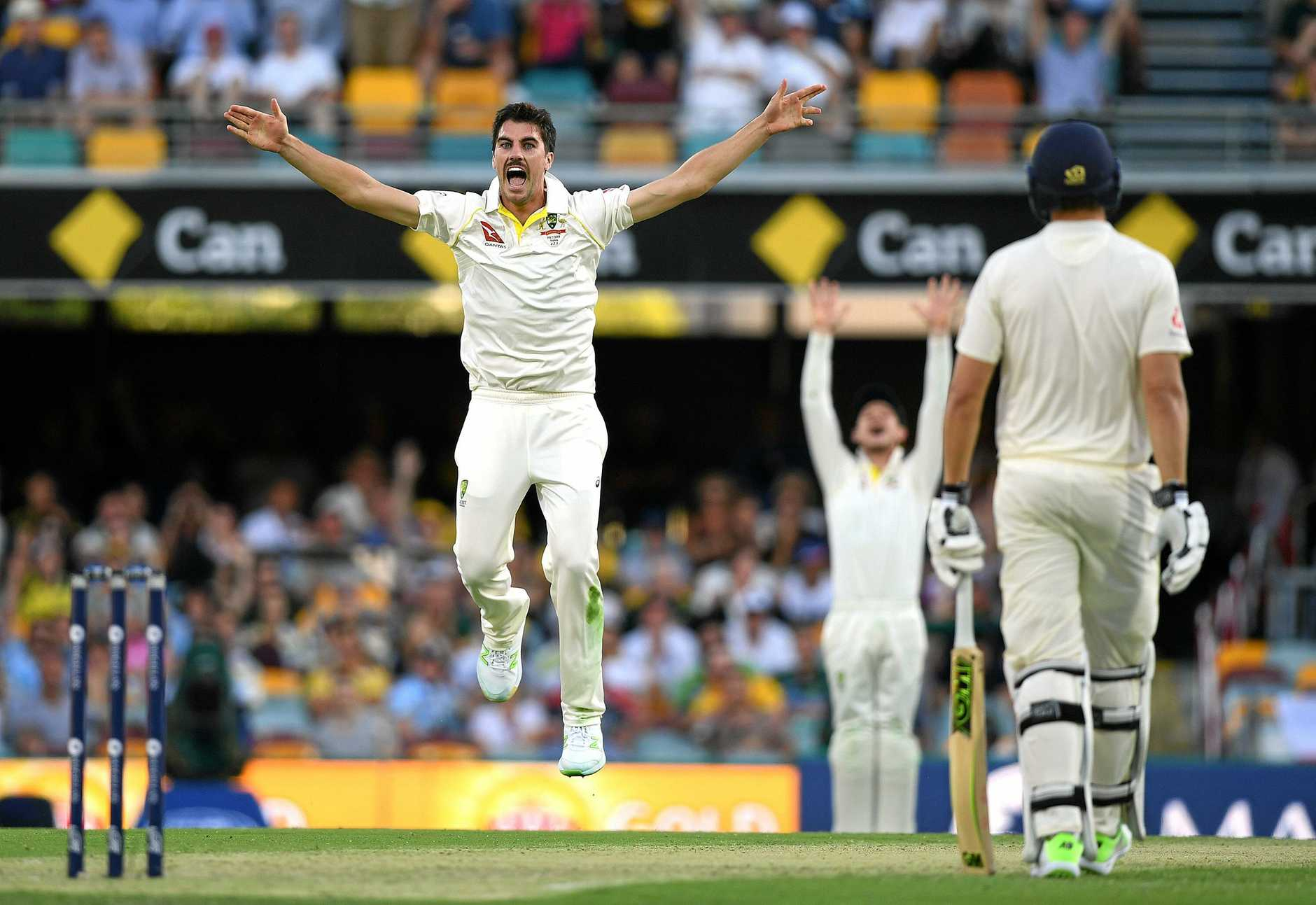 Pat Cummins celebrates after dismissing England captain Joe Root on the opening day of the Test.