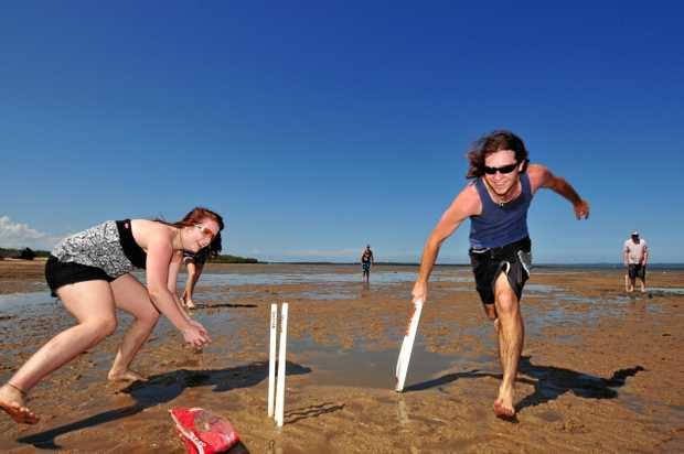Jess McCall runs out Damien Hughes in a very serious game of beach cricket at Maaroom.