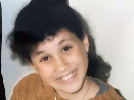 Meghan Markle is all smiles as a young girl proudly showing off her natural hair. Picture: Supplied.