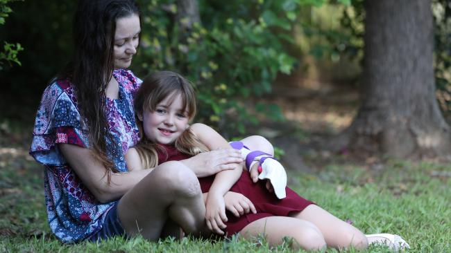 Charli Allen, 8, with her mum Jo, who was brutally attacked with a machete. Picture: Peter Wallis