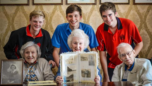 Rostrevor College students Nathan McCarthy, 16, Clinton Nitschke, 15, and Patrick Fleming, 15, with Walkerville Allity retirement village residents Florence Wheeler, 102, Kathy Beasley, 93, and Derick Wright, 95. Picture: AAP/Roy VanDerVegt