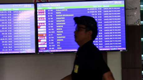Flight boards show all flights at Bali's Denpasar airport have been cancelled on Monday due to volcanic ash. Picture: Lukman S. Bintoro
