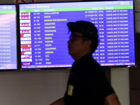 Flight boards show all flights at Bali's Denpasar airport have been cancelled on Monday due to volcanic ash