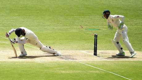 Tim Paine showed quick hands and a quicker mind to stump Moeen Ali.