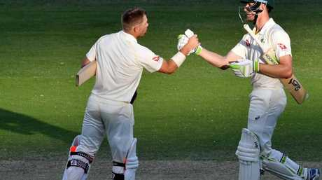 David Warner (left) and Cameron Bancroft (right) of Australia congratulate each other at stumps on Day 4.