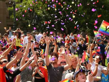 People in Melbourne celebrate as the postal survey result is announced. Picture: Scott Barbour/Getty Images