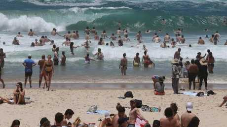 Schoolies in big surf at Surfers Paradise Beach. L-R Picture Mike Batterham