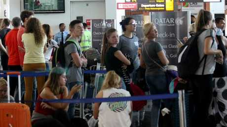 Passengers wait for information relating to their flights at Denpasar airport. Picture: Lukman S. Bintoro