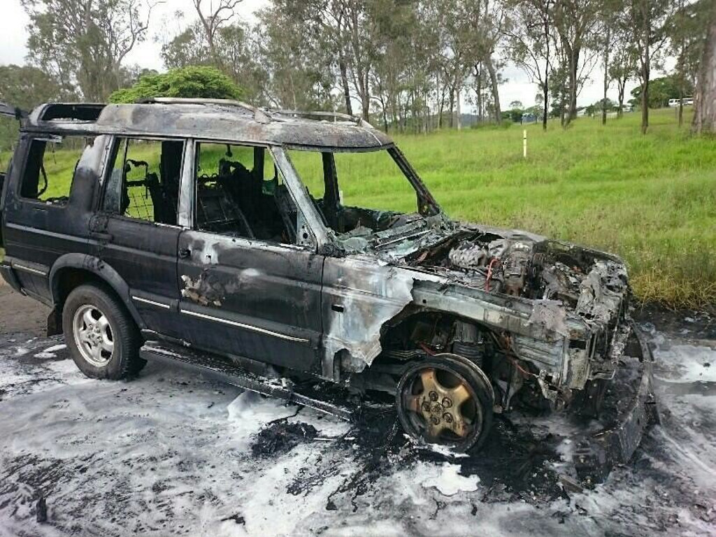The remains of a burnt out Land Rover after it went up in flames on the Bruce Highway south of Tiaro.
