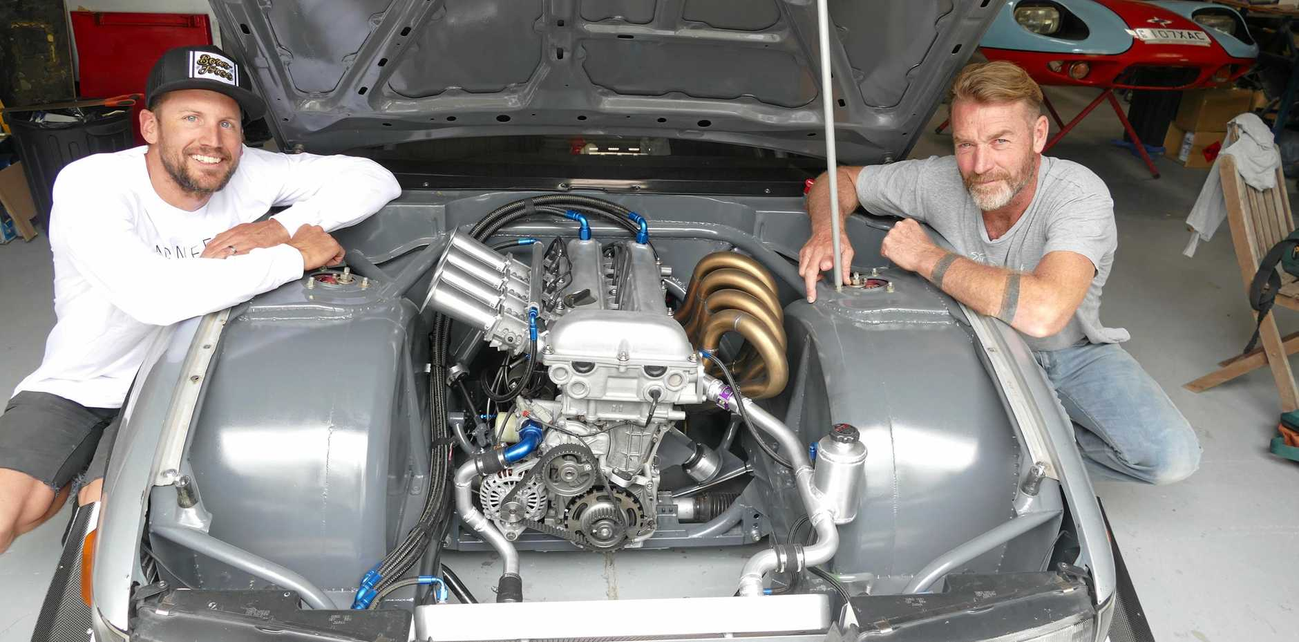 IT'S A SECRET: Nigel Petrie, left, and Warren Cooper look over an engine part they're working on in Nigel's 1989 Nissan Silvia for a prominent Australian automotive company to take onto the international market.