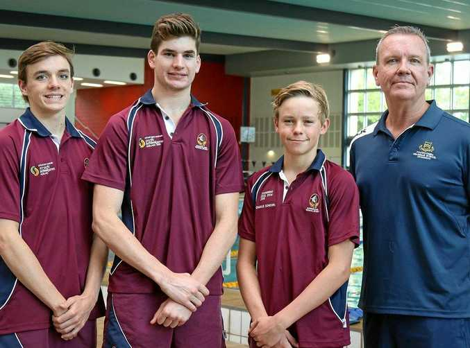 Toowoomba Grammar School swimmers Lachlan Constable, Josh Smith and Charlie Schoorl with head coach Richard McLean.