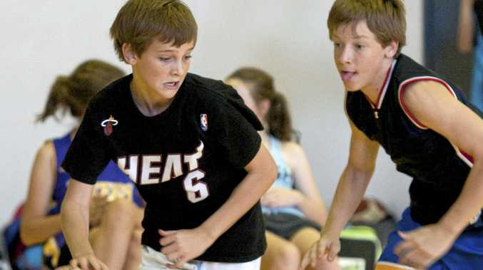 ON COURT: Riley Dreghorn (left) takes on Bayden Goff at a previous Supercamp.