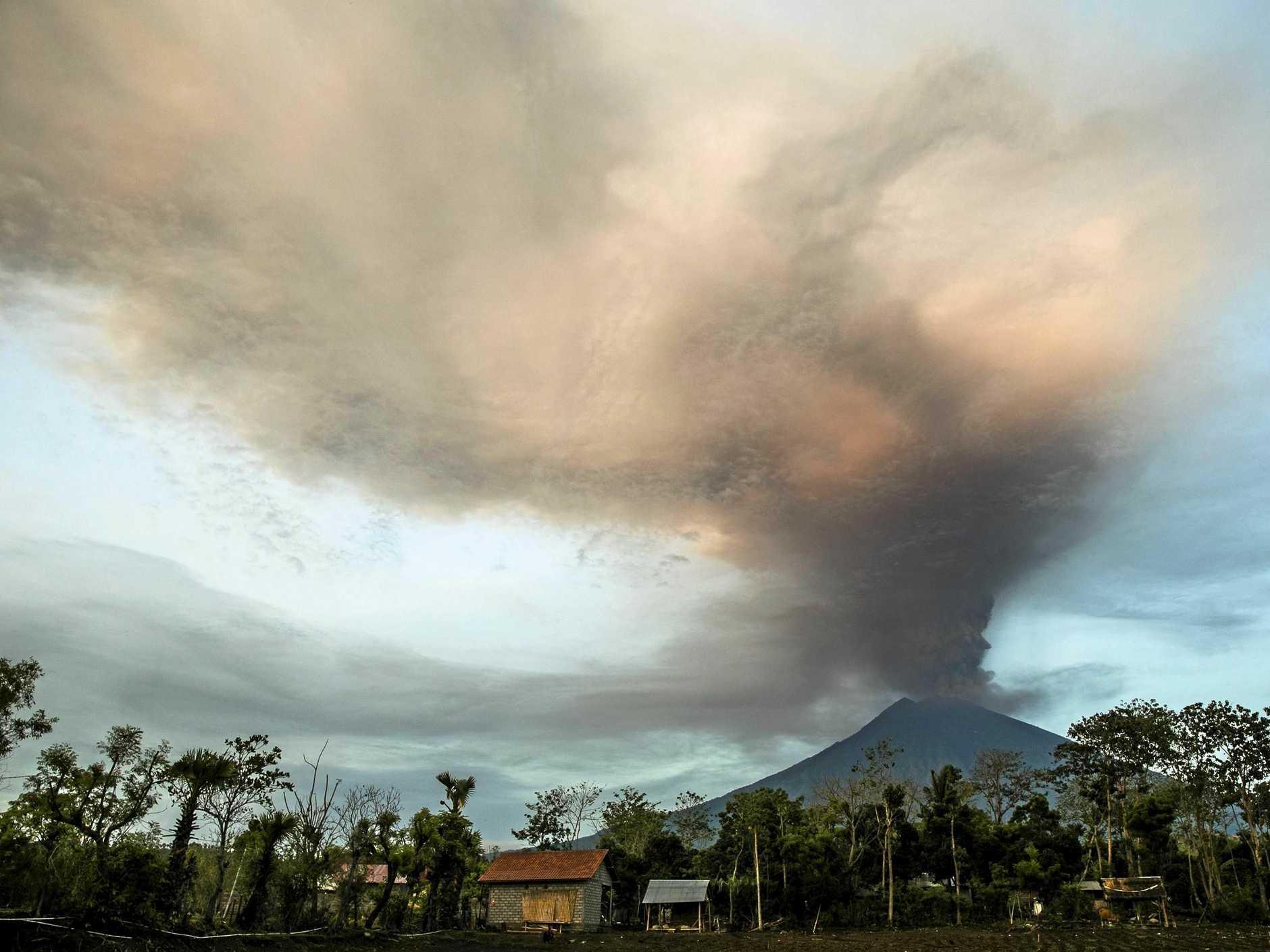 ERUPTING: The Mount Agung volcano spews hot volcanic ash, as seen from Datah, Karangasem, Bali, Indonesia