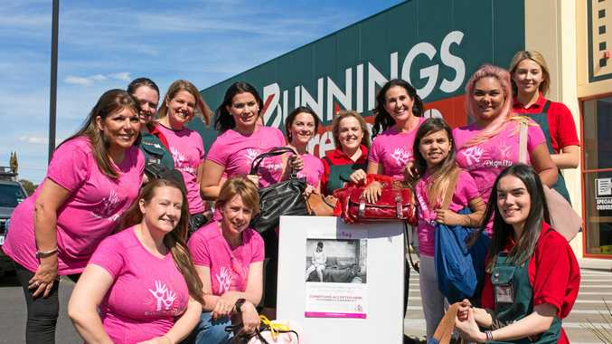 SHARING CHRISTMAS: Members from Bunnings and Share the Dignity want your handbag.