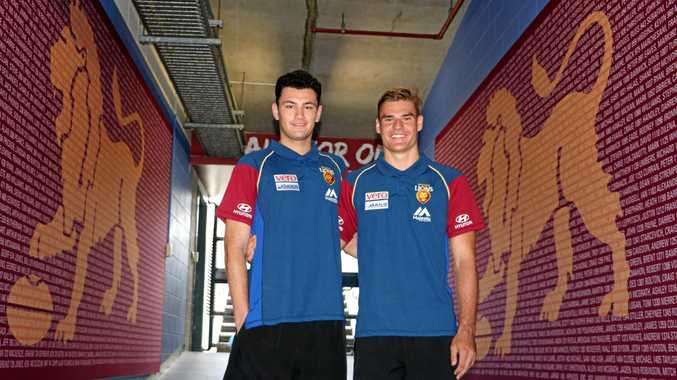 TOURING THE FACILITIES: Lions recruits Connor Ballenden and Jack Payne.